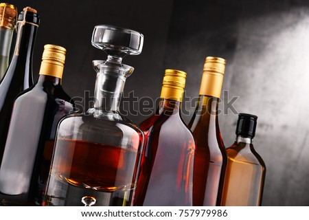 Composition with carafe and bottles of assorted alcoholic beverages. #757979986