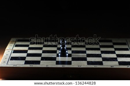Composition with chessmen on glossy chessboard #136244828