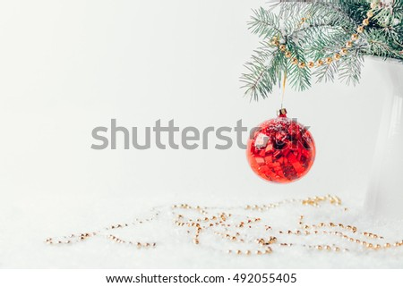 Composition with Christmas decorations in vase on white background #492055405