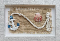 Composition with clay anchor, white rope and seashell. Image for a card or background with a memory of a vacation at sea. Symbol of relaxation on a yacht. Delicate Pastel Colors. Soft focus