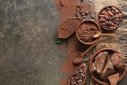 Composition with cocoa powder and chocolate on dark background