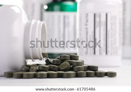 Composition with containers of dietary supplements and chlorella pills