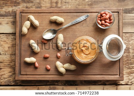 Composition with creamy peanut butter on kitchen table #714972238