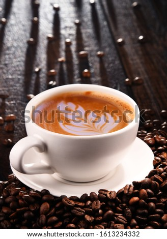 Composition with cup of caffe latte and coffee beans. Foto d'archivio ©