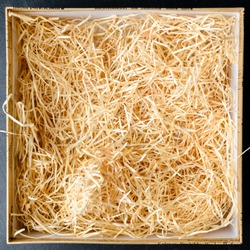 Composition with decorative straw in a box, close-up. Top view, flat lay