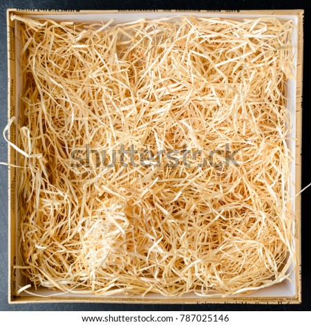 Composition with decorative straw in a box, close-up. Top view, flat lay Stock photo ©