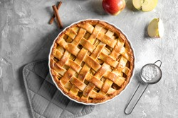 Composition with delicious apple pie on light background