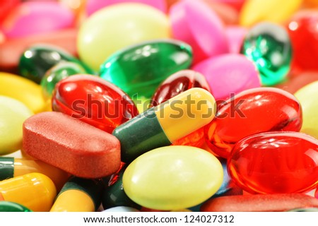Composition with dietary supplement capsules and drug pills