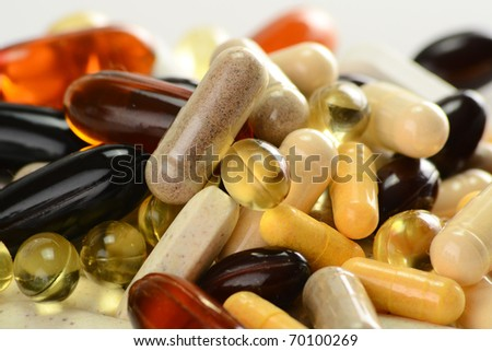 Composition with dietary supplements capsules. Variety of drug pills.