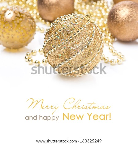 composition with different golden Christmas balls, isolated on white, close-up