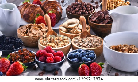 Composition with different sorts of breakfast cereal products and fresh fruits. #1296717874