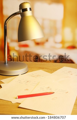 Composition with exam paper, pencil and lamp on table on bright background