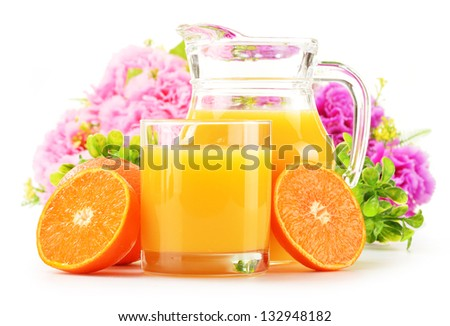 Composition with glass and jug of orange juice