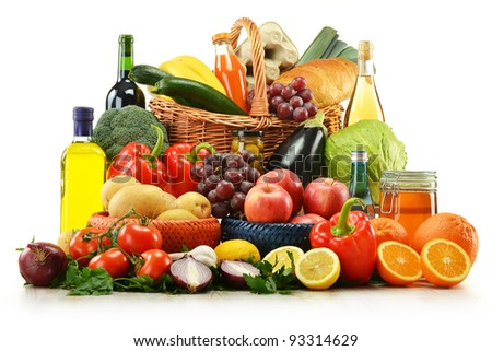 Composition with groceries and basket isolated on white. Vegetables, fruits, wine and bread.
