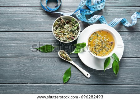 Composition with herbal tea on wooden table. Weight loss concept