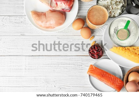 Composition with high protein food, powder and shake on wooden background