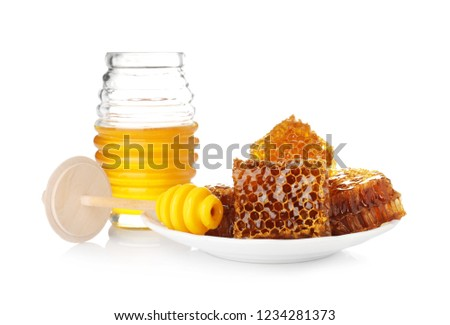 Composition with jar of honey on white background #1234281373