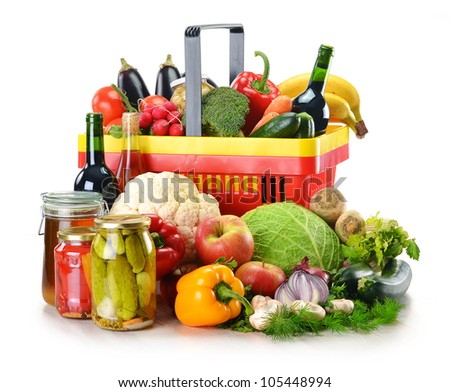 Composition with plastic shopping basket and grocery isolated on white