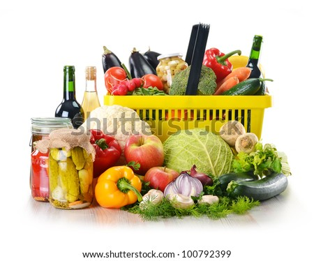 Composition with plastic shopping basket and grocery isolated on white. Variety of food products.