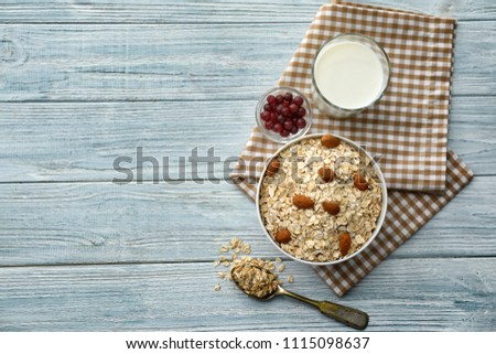 Composition with raw oatmeal on wooden background #1115098637