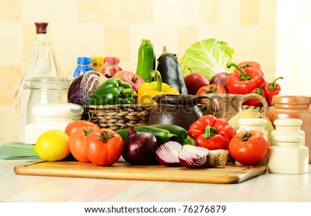 Composition with raw vegetables on kitchen table