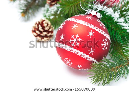 composition with red Christmas ball and fir branches isolated on white background