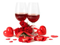 Composition with red wine in glasses, red roses, ribbon and decorative hearts on light background