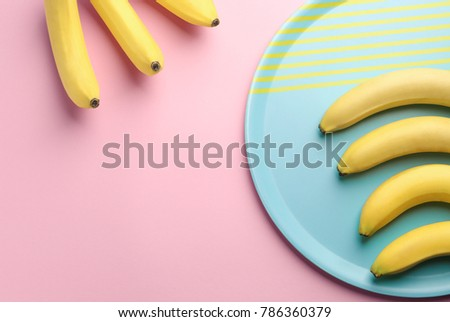 Composition with ripe bananas on color background - Shutterstock ID 786360379