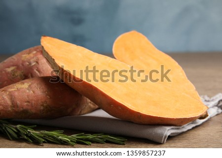 Composition with ripe sweet potatoes on wooden table, closeup #1359857237