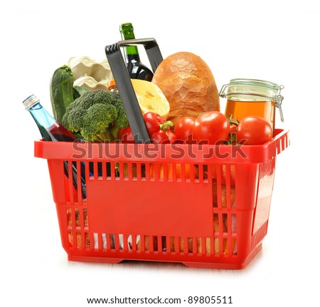 Composition with shopping basket and groceries isolated on white - stock photo