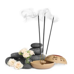Composition with smoldering incense sticks, roses and spa stones on white background