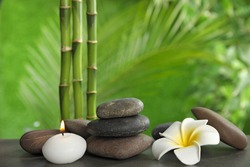Composition with stones on table against blurred background. Zen concept