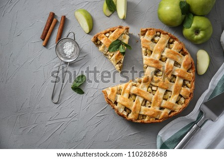Composition with tasty homemade apple pie on table #1102828688