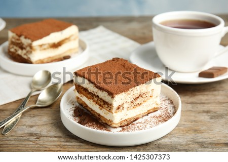 Composition with tiramisu cakes and tea on table Photo stock ©