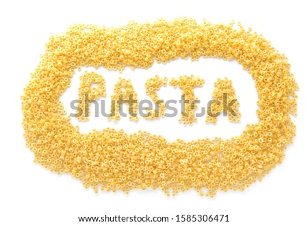 Composition with uncooked pasta on white background