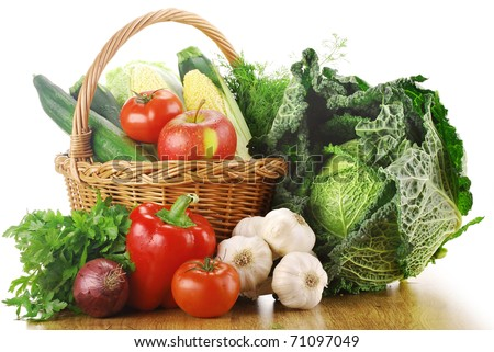 Composition with variety of fresh organic vegetables and wicker basket isolated on white