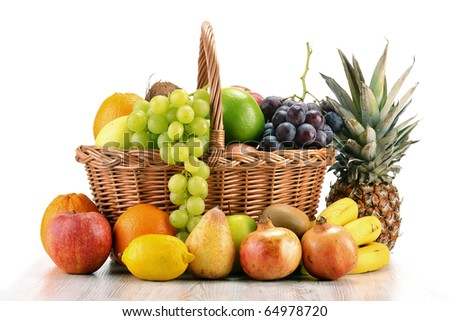 Composition with variety of fruits and wicker basket isolated on white