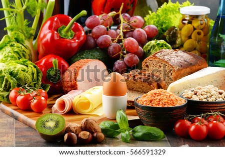 Composition with variety of organic food products on kitchen table #566591329