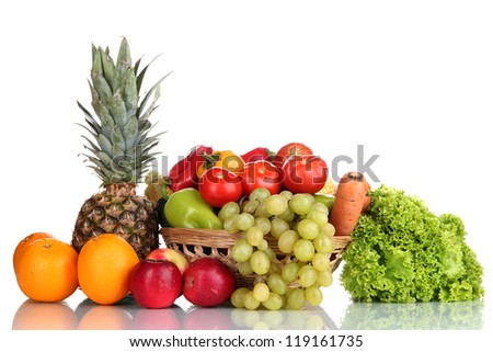 Composition with vegetables and fruits in wicker basket isolated on white