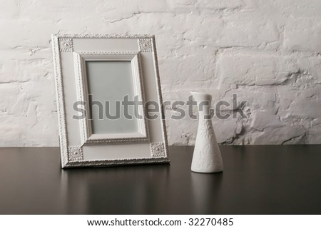 composition with vintage foto frame and vase