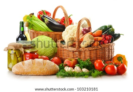 Composition with wicker basket and grocery isolated on white