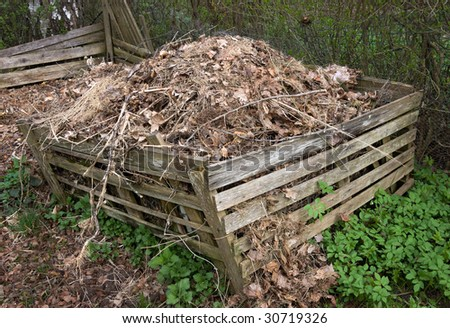 Compost heap in a wooden box