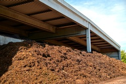 composted soil pile at the compost plant. Compost and composted soil as a composting pile. turning into organic fertilizer garden earth. Fertile ground. recycle industry, environment fertilizer.