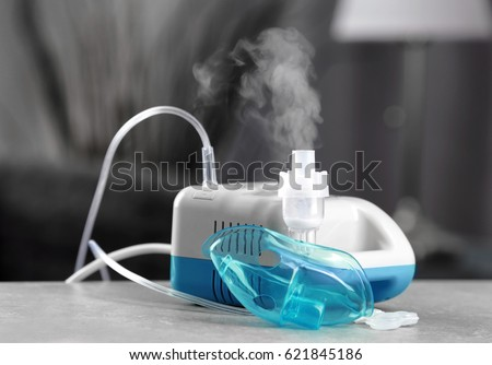 Compressor nebulizer with mask on table Foto stock ©