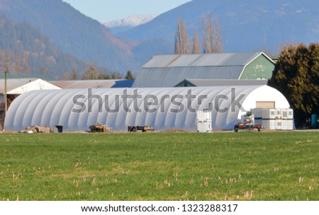 Comprised of light weight fabric and wire framing, a temporary farm building can be installed quickly on sight.  #1323288317
