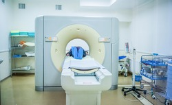Computed tomography or computed axial tomography scan machine with patient in hospital room