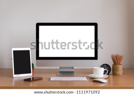 Computer all in one, tablet, smartphone, clock, pencils and coffee cup on wooden table #1111971092