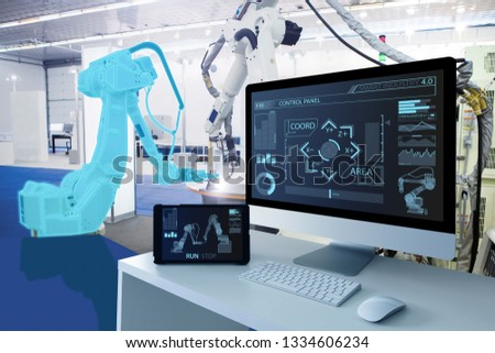 Computer and digital tablet for control of robots in a smart factory. Smart industry 4.0 concept