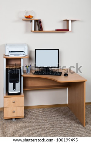 computer and printer on the desk in the office