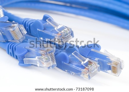 Computer and VOIP data cables against white